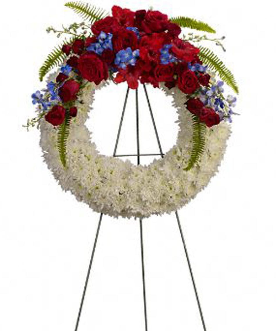 Reflections of glory patriotic funeral wreath rochester florist sympathy wreath of white flowers topped with red and blue blooms for a patriotic tribute izmirmasajfo