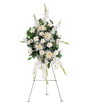 Sympathy spray of white carnations, chrysanthemums and gladioli.