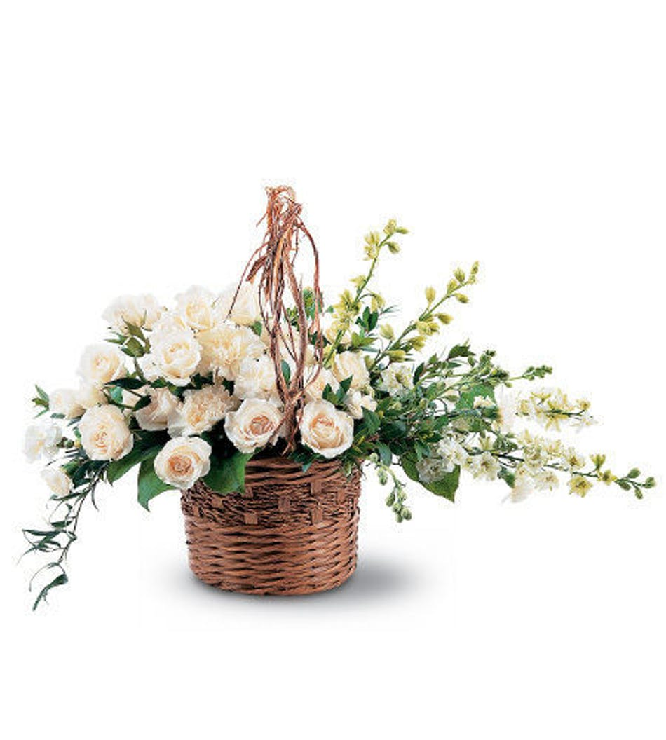 Basket of light white sympathy arrangement rochester ny white carnations larkspur and roses in a wicker basket mightylinksfo