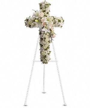 Sympathy cross of creme roses, white lilies, chrysanthemums, stock, and more.