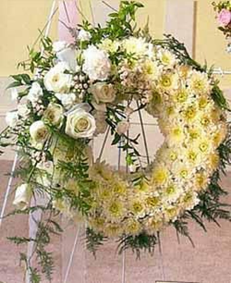 Pure white beauty wreath rochester funeral flowers sympathy wreath of white poms accented with white roses ribbon and greenery izmirmasajfo