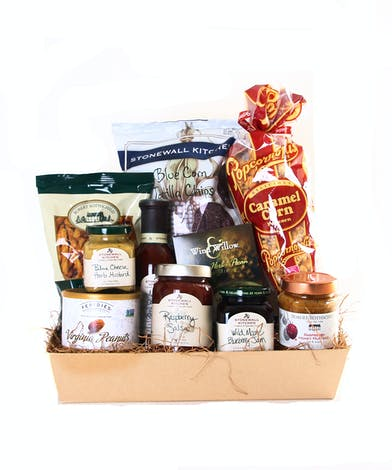 Basket filled with gourmet items including dipping oils, dessert sauces, dips and salsa.