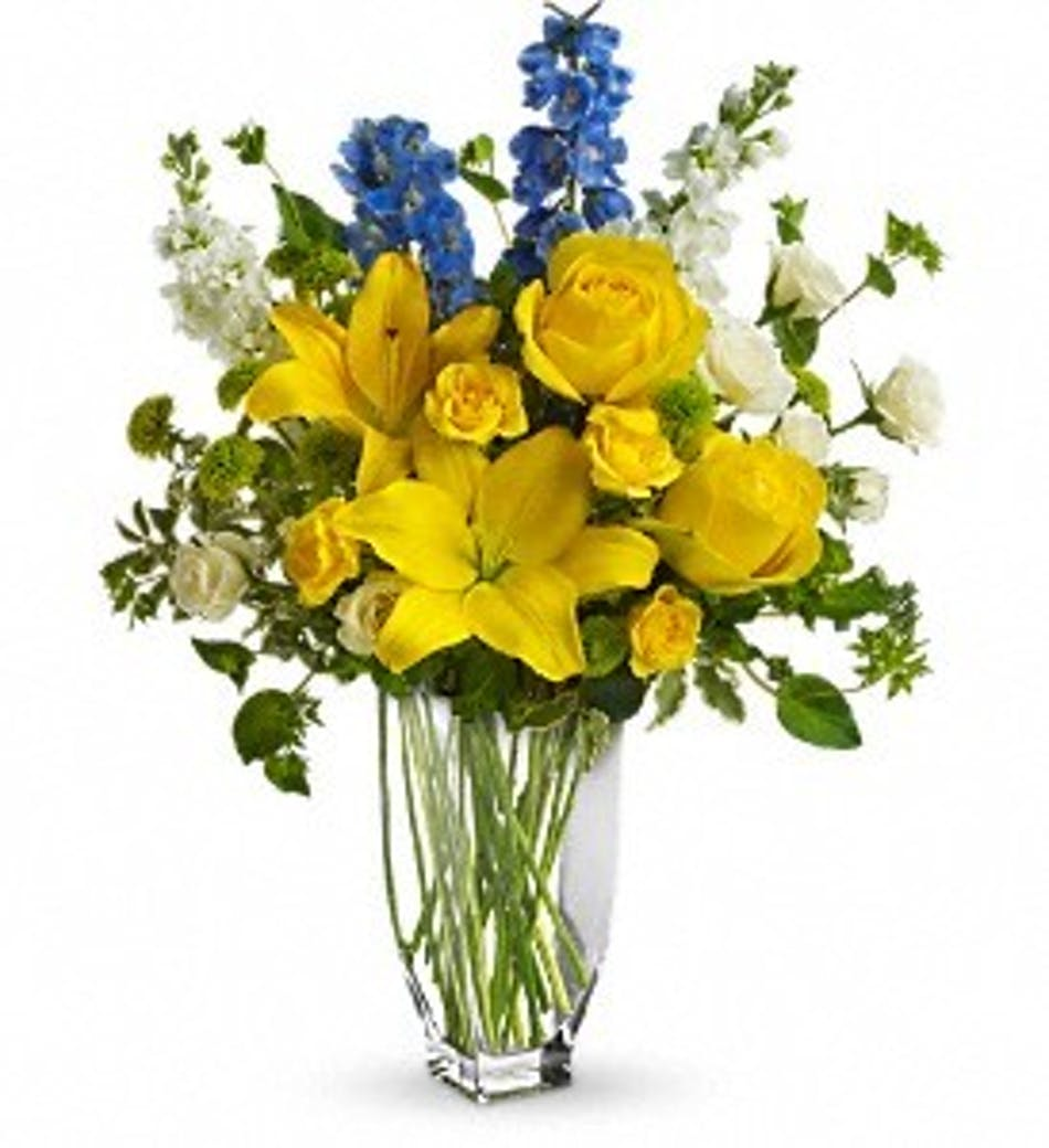 Meet me in provence rochester florist flower delivery yellow and blue flowers in a tall glass vase izmirmasajfo