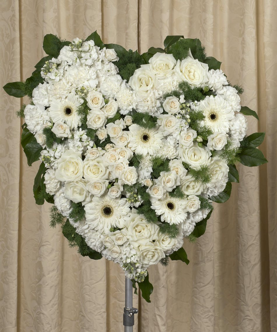 Elegant white funeral heart kittelberger florist sympathy heart of all white roses orchids lilies gerbera daisies and greenery izmirmasajfo