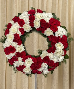 Funeral wreath of red and white flowers.