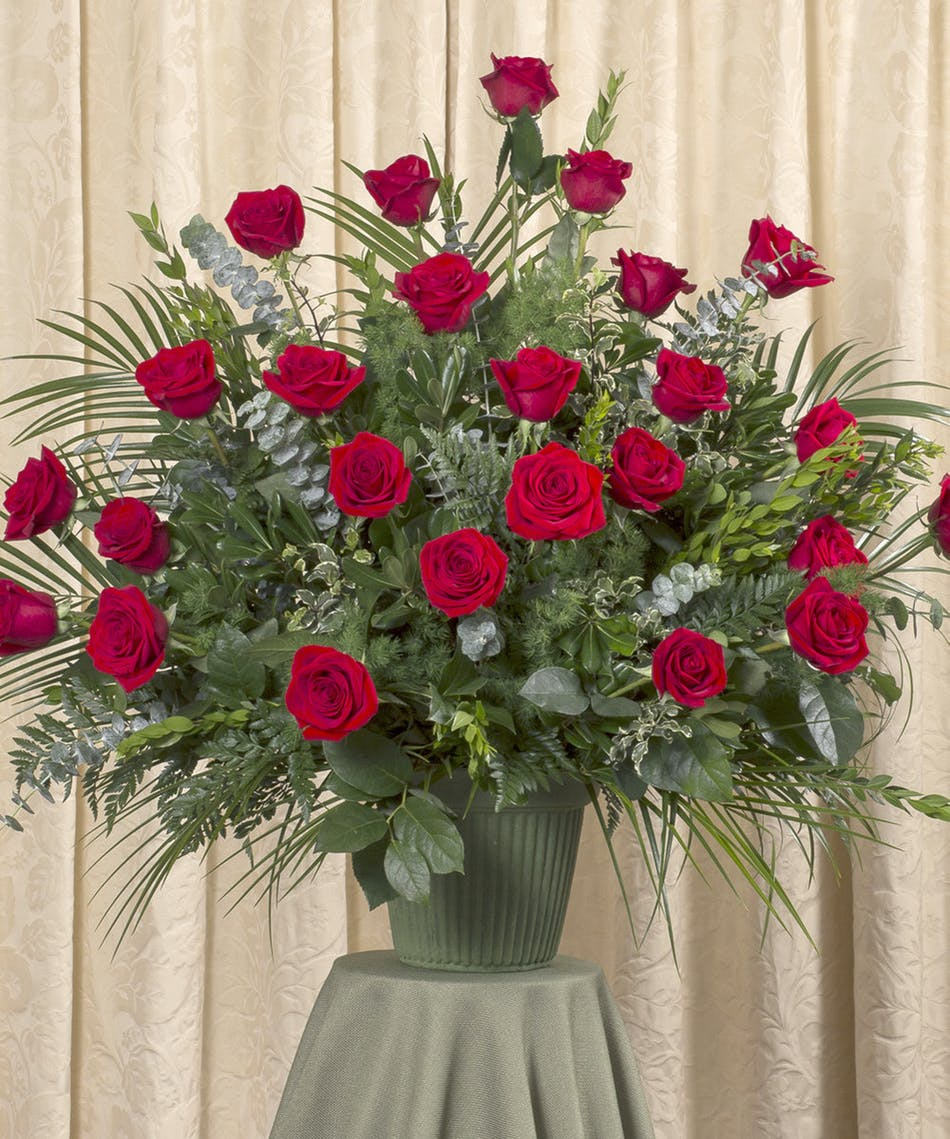 Red rose funeral arrangement kittelberger florist rochester sympathy arrangement of two dozen red roses and assorted foliage izmirmasajfo
