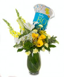 Yellow and blue flower arrangement with a baby boy balloon.