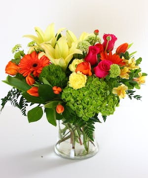 Bright spring flowers in a glass vase.