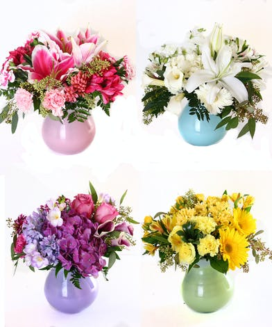 Four monochromatic flower arrangements each in a matching vase.