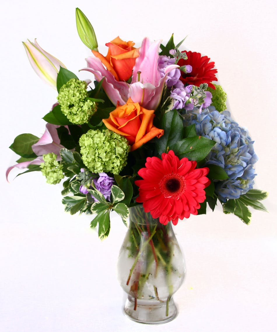Bunches of blooms rochester webster flower delivery roses lilies hydrangea and other flowers in a clear glass vase izmirmasajfo