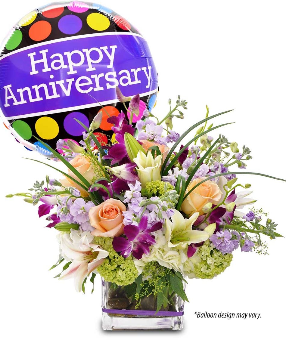 Anniversary dazzler rochester anniversary flowers purple dendrobium orchids peach roses and green hydrangea in a cube vase accompanied by a izmirmasajfo