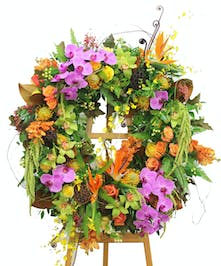 Sympathy wreath of bright flowers.