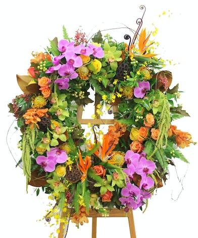 Sympathy wreath of bright flowers.