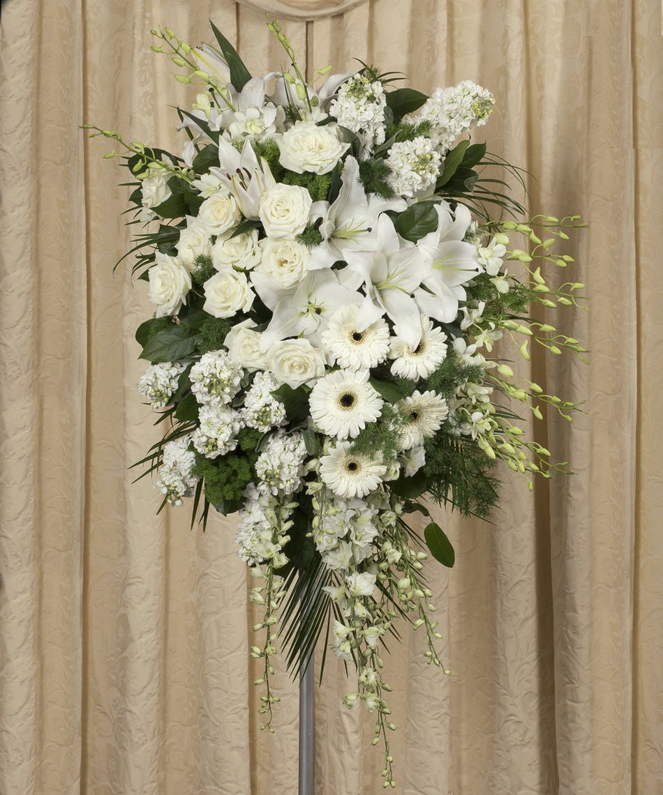 Elegant white standing spray funeral flowers rochester sympathy spray of white roses hydrangea orchids lilies gerbera daisies and greenery izmirmasajfo