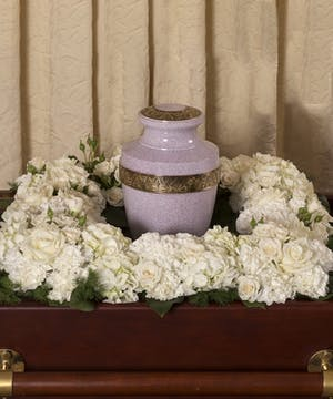 Square wreath of white flowers to surround an urn.