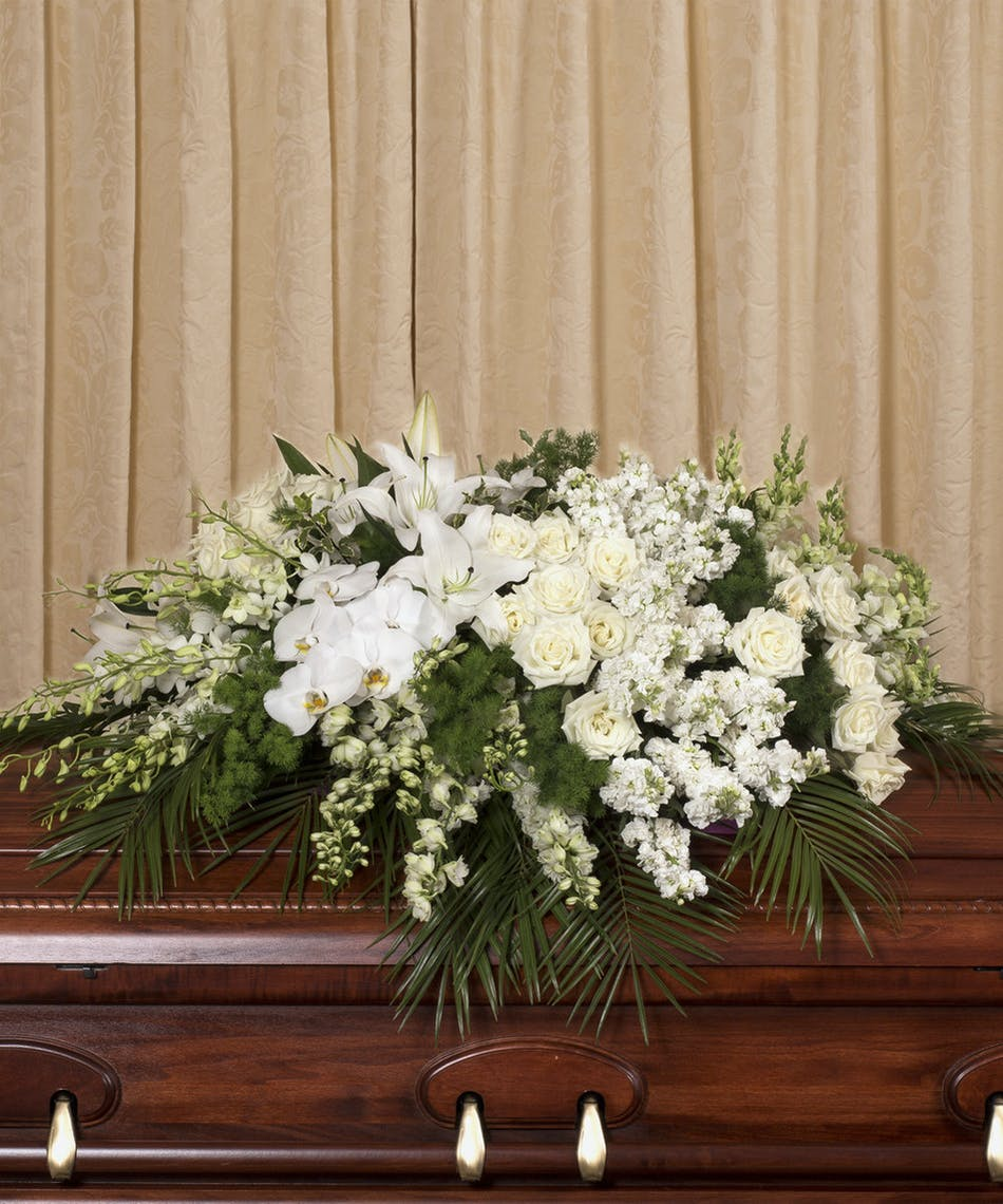 Elegant white casket spray rochester funeral flowers casket spray of all white roses orchids lilies and more izmirmasajfo