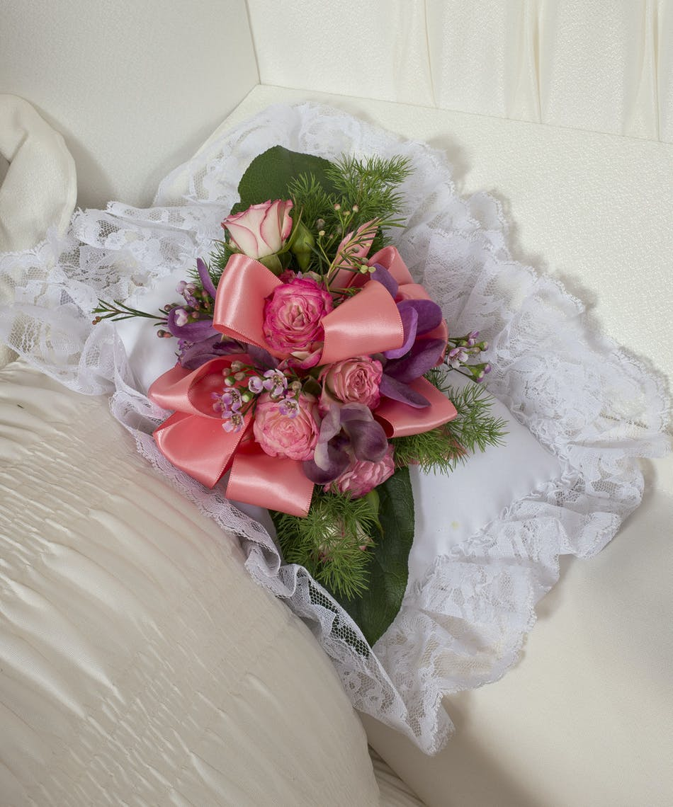 Pastel flowers for satin pillow kittelberger florist satin pillow accented with pastel roses and orchids mightylinksfo