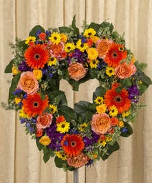 Sympathy heart of roses, delphinium, gerbera daisies and more in vibrant colors.