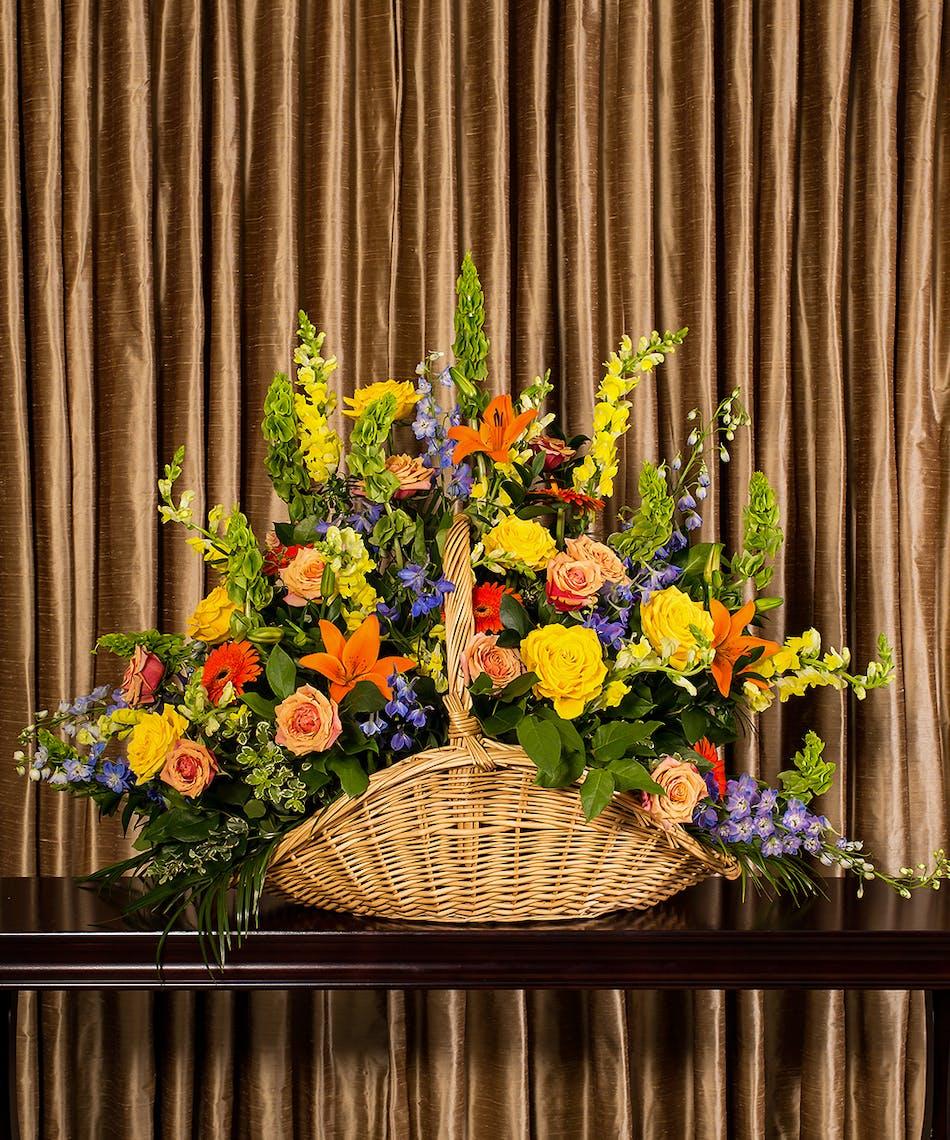 Glowing tribute basket rochester funeral flowers izmirmasajfo