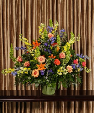 Sympathy basket of colorful flowers.