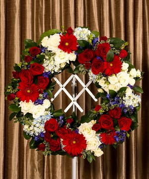 Mixed patriotic colored flowers in a wreath