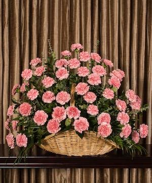 Sympathy basket of pink carnations.