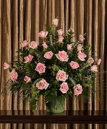 Funeral arrangement of pink roses.