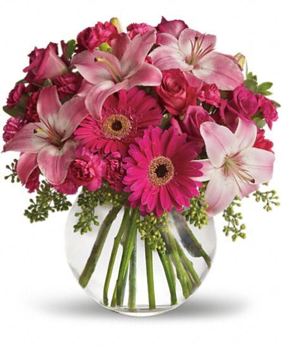 A little pink me up pink flower arrangement rochester ny florist pink roses lilies daisies and carnations in a glass bubble bowl vase mightylinksfo