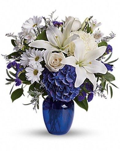 White flowers in a blue cobalt vase
