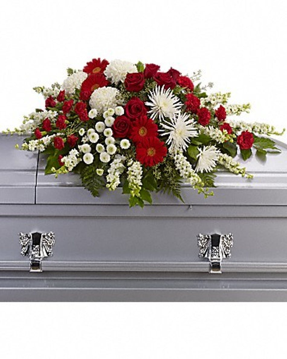 Strength and wisdom casket spray ny casket flowers red and white floral casket spray accented with greenery izmirmasajfo