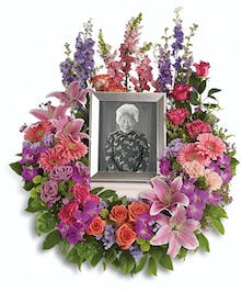 Sympathy wreath of pink and purple flowers to surround an urn or photograph.