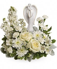 White roses, alstroemeria and stock surrounds a keepsake angel sculpture.