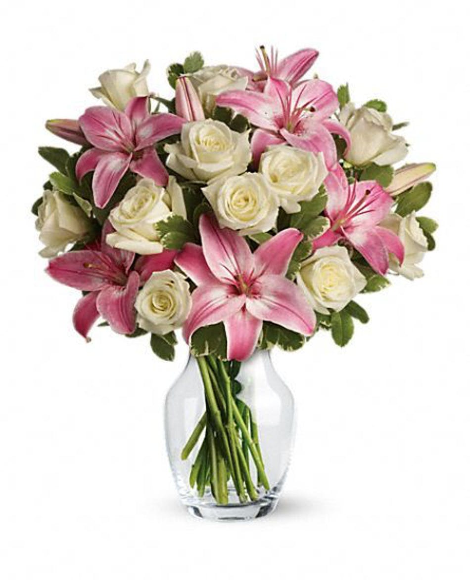Always a lady lily rose bouquet same day delivery one dozen white roses mixed with pink lilies in a clear glass vase izmirmasajfo