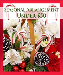 Christmas arrangement designed by the experts at Kittelberger Florist.