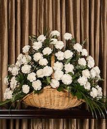 Sympathy basket of white carnations.