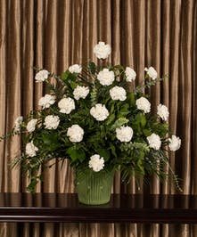 Funeral arrangement of white carnations.