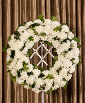 Sympathy wreath of white carnations.