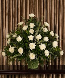 Sympathy arrangement of white roses.