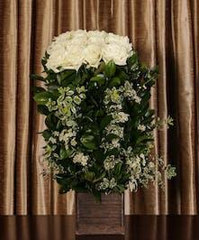 Sympathy hedge arrangement of white roses.