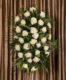 Sympathy spray of white roses.