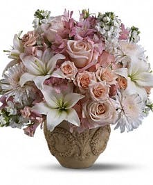 Bouquet of blush pink and white flowers in a Garlands of Grace urn.