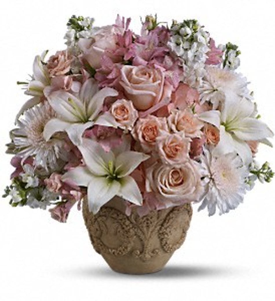 Garden of memories roses lilies rochester sympathy flowers bouquet of blush pink and white flowers in a garlands of grace urn mightylinksfo