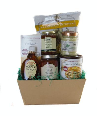 Gift basket filled with gluten free snacks and baking mixes.