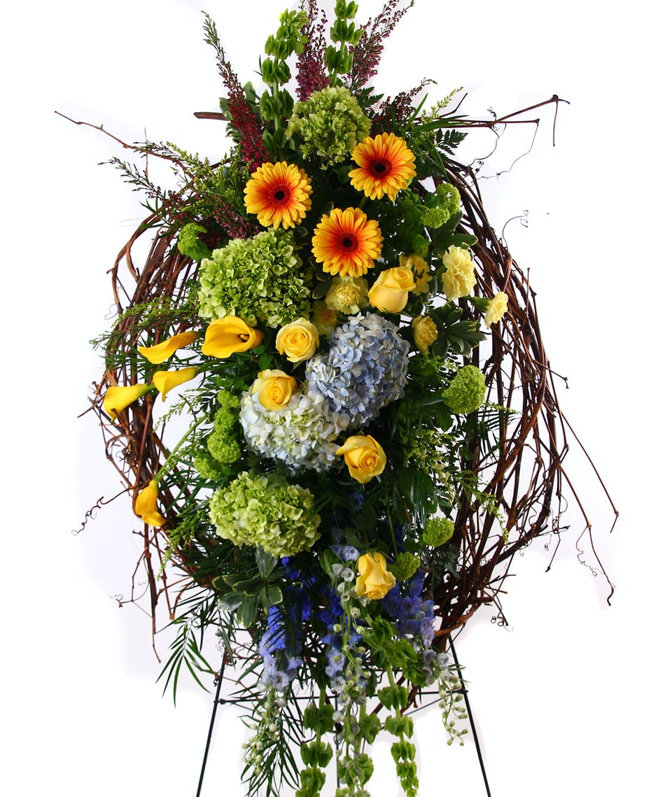 Gracious goodbye rochester funeral flower delivery sympathy spray of hydrangea calla lilies gerbera daisies roses grapevine and more izmirmasajfo