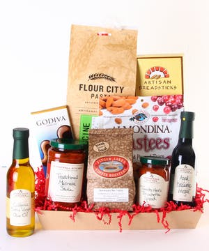 Gift basket filled with gourmet pasta, sauce, vinegar, oil, breadsticks, coffee, biscotti and more.