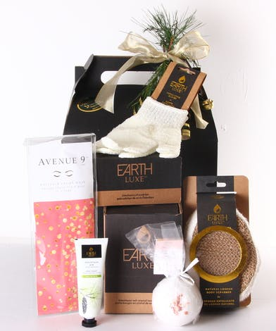 Spa basket with lotion, a mask and more in a box with greenery trim