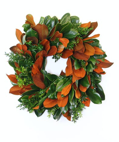 Hand made wreath of winter greenery in a variety of styles and colors.