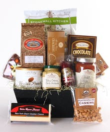Gourmet basket filled with cheddar cheese, crackers, coffee, sausage and more.